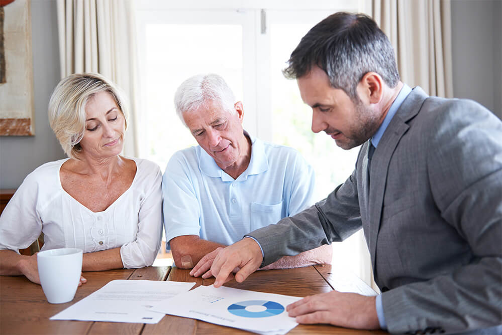 financial advisor with retired couple